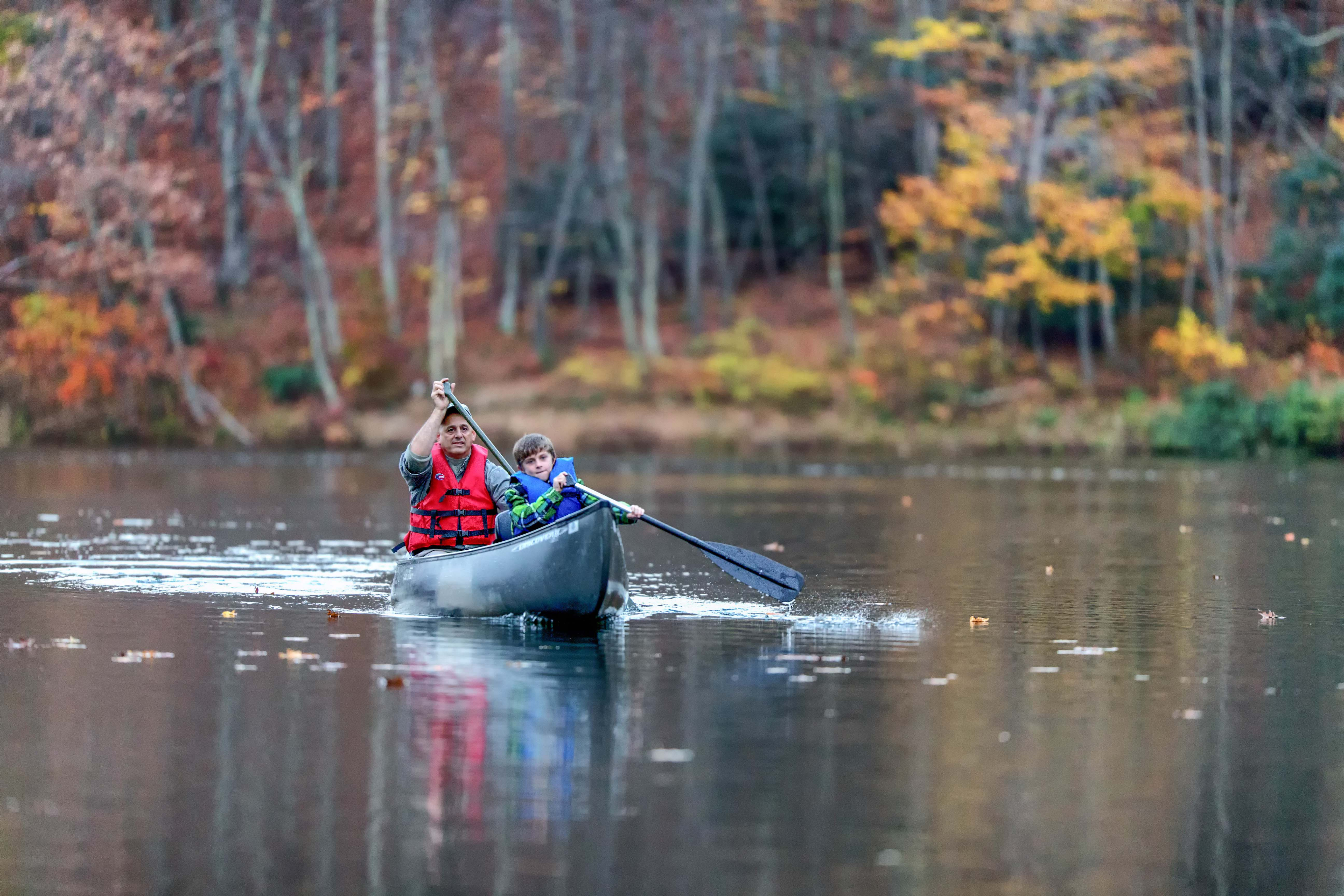 People paddling canoes on Norton's Upper Reservoir